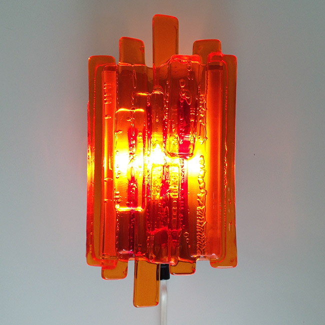 Late 1960s Danish hygge fire-effect wall light designed and made by Claus Bolby