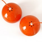 Danish space-age ball pendant lights pair in glossy bright orange, 1960s