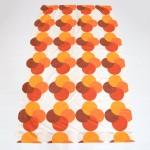 Semi-translucent curtain with bold geometric design in orange, 1970s Danish