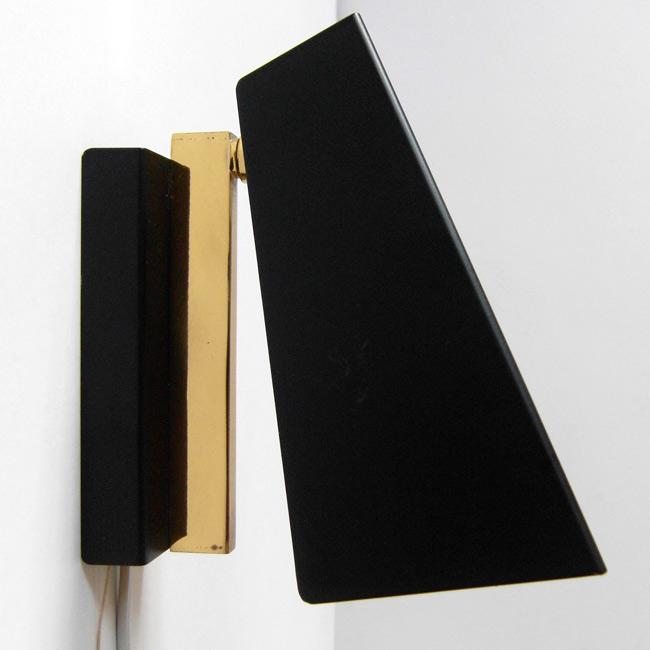 Matte black and brass clamshell wall light
