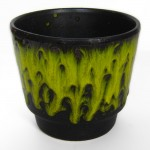 Plant pot with yellow-green fat lava drip glaze