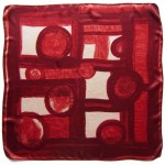 Vintage headscarf with abstract design in rich reds