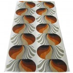 Bold geometric fabric with silver frond lozenges