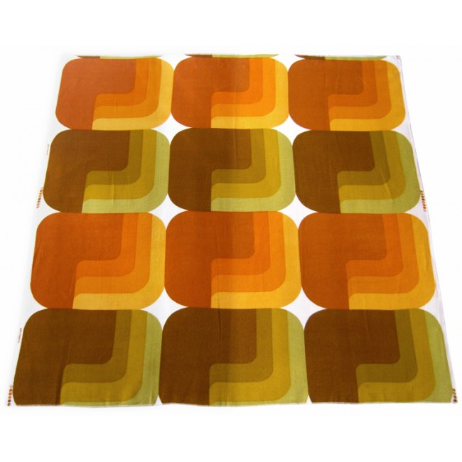 Geometric lozenge textile in muted greens and oranges